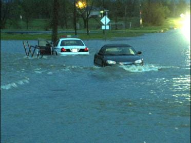 Drivers Rescued From Cars Stalled In High Water
