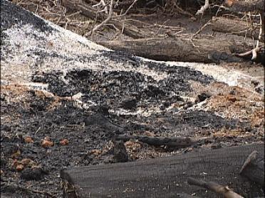 Debris Pile Burns Boy
