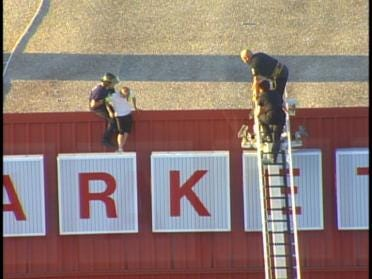 Teen Removed From Store's Roof