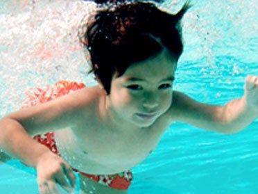 Children Learn Water Survival Techniques