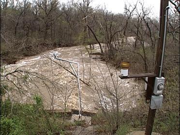 Neighborhood Braces For Possible Flooding