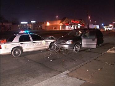 Woman Crashes Into Police Car