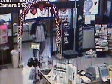 Drug Store Robber Sought