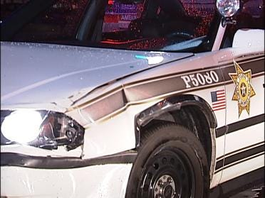 Driver Hits Police Car Responding To Call