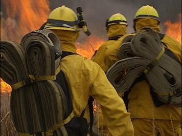 Fire Crews Study Hand To Flame Combat