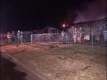 House Fire Spreads Next Door