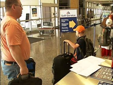 Travelers Getting Around Airline Luggage Fees