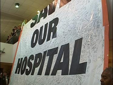 Hospital Workers Unveil Banner