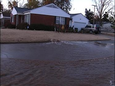 Water Leak Floods Tulsa Street