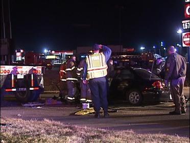 Driver Injured After Car Hits Semi