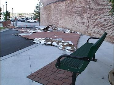 Strong Winds Cause Damage In Downtown