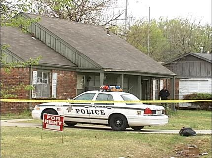 Body Found In Tulsa Yard, Two Arrested