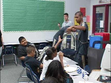 TU Students Give Backpacks To Elementary Students