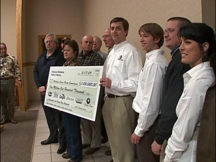 Poultry Council Gives Check To River Group