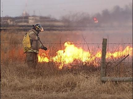 Firefighters Track Wild Fire Conditions