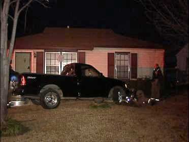 Woman Arrested After Pickup Hits Tulsa Home
