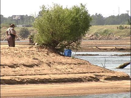 Investigators Work To Identify Body Found In Arkansas River