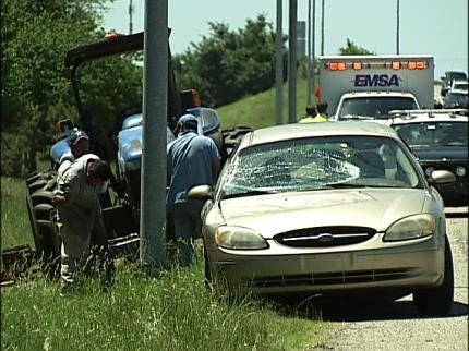 Power Pole Falls On Car On Highway 75