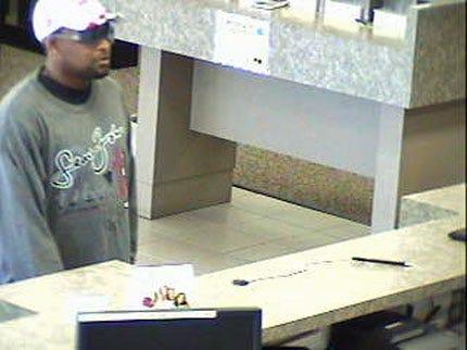 Suspect Waves Gun In Tulsa Bank, Then Flees