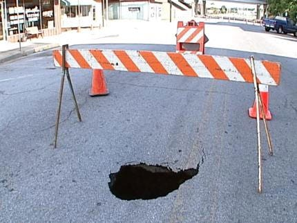 Sinkhole On Main Street In Sand Springs Reveals Need For More Repairs