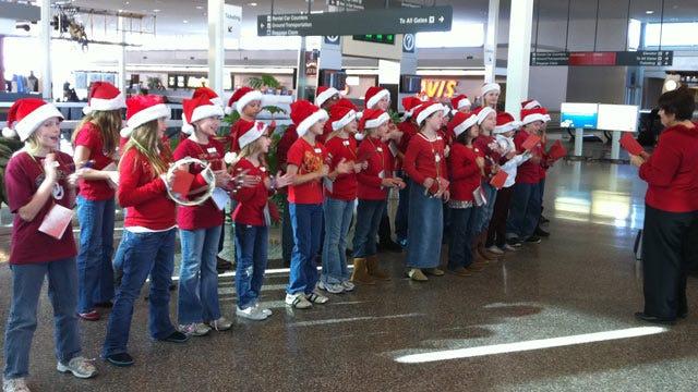 Holiday Carolers Provide Travel Music At Tulsa International Airport