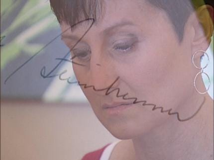 Tulsa Woman Gets Kiss - And Autograph - From Steinbrenner