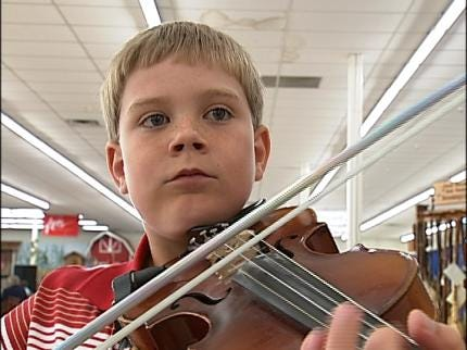 Music Lovers Have Fiddle Fever In Grove
