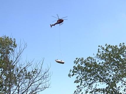 Helicopter Lifts Boat Stuck In Sandbar At Keystone Lake