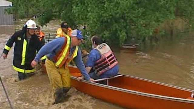 Firefighters Rescue Man, Dogs From Flooded Adair County Home