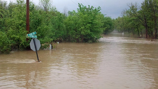 Okmulgee County Flood Washes Out Roads, Buries Vehicles