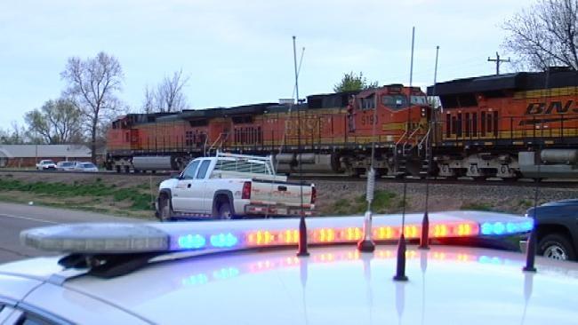 Freight Train Strikes Car Near Sand Springs