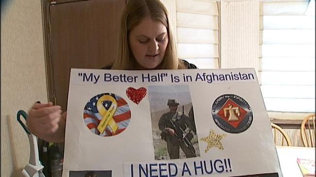 Keith Urban Hugs Oklahoma Army Wife Over Poster
