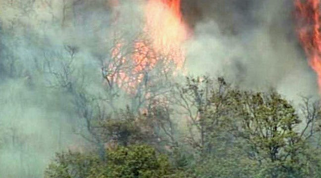 Firefighters, Helicopter Battle Large Grassfire Near Cushing