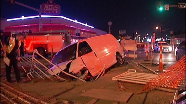 Van Lands In Hole, Driver Taken To Tulsa County Jail
