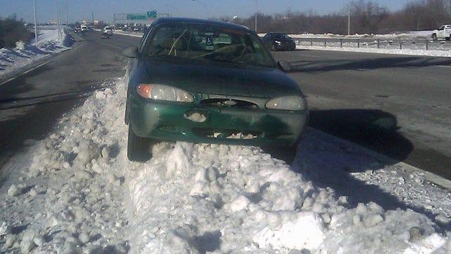 Car Resting On Tulsa Highway Snow Bank Turns Heads