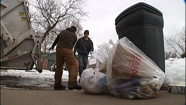 Trash Haulers, Mail Carriers Play Catch Up After Blizzard