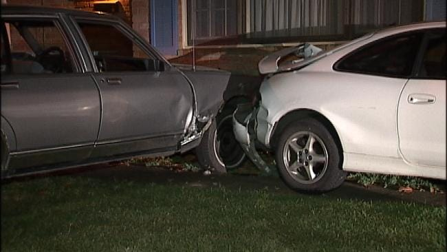 Tulsa Man Arrested After His Car Strikes Home Early Thursday