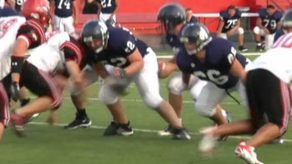 Altus Bulldogs' Quarterback Taken Off Field on Stretcher