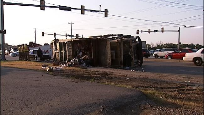 Garbage Truck Rollover Causes Mess At 71st And Garnett