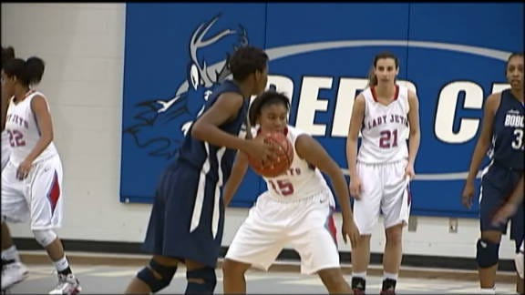 Star Spencer Holds off Western Heights, 45-38