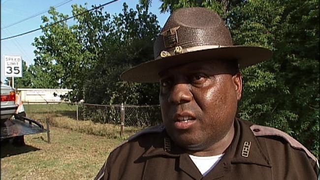 Tulsa Driver Sideswipes Highway Patrol Car Chasing Runaway Trailer