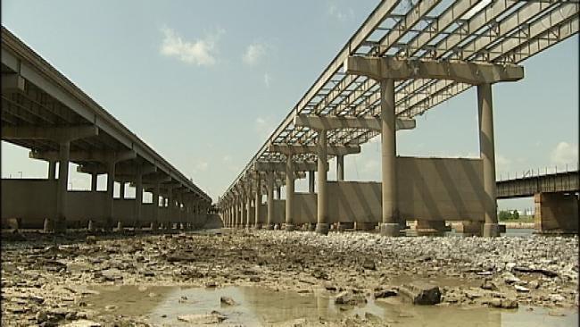 Are Contractors Really Dumping I-244 Bridge Debris Into The Arkansas River?