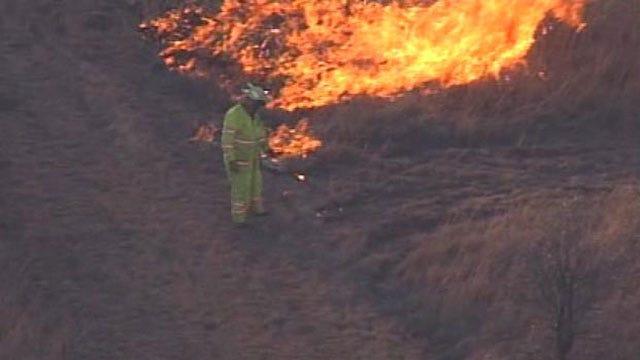 Firefighters Battle Grass Fire Near Olive