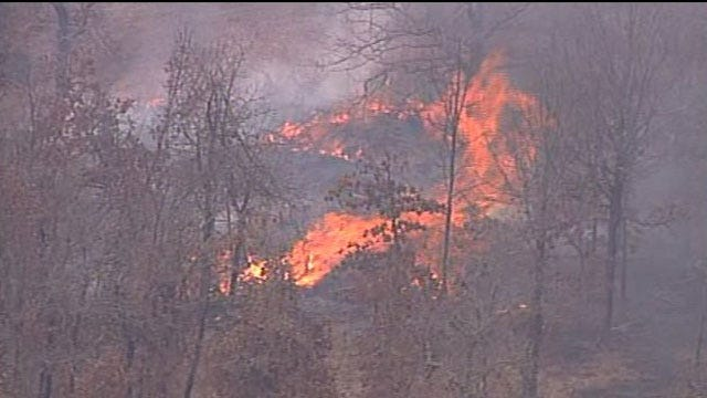 Firefighters Battle Creek County Grass Fire