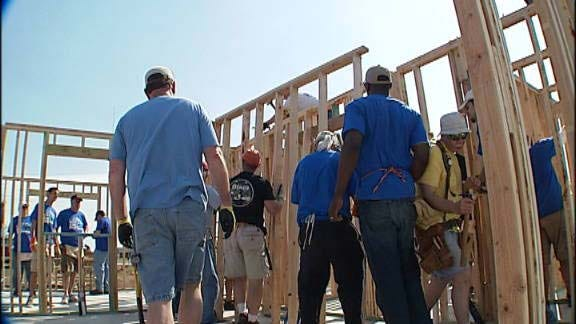 Former OSU Star Helps Build Family's New Home