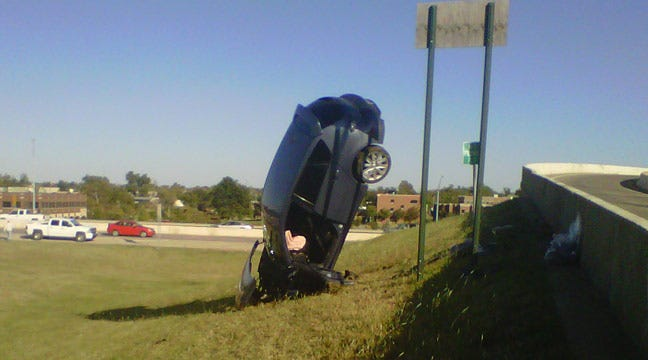 Car Nose Dives Into Ground Off Tulsa's IDL