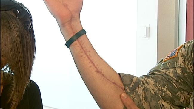 Wounded Owasso Soldier Returns To Family's Embrace