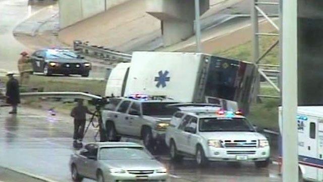 EMSA Ambulance Rolls Onto Its Side In Downtown Tulsa