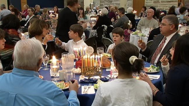 Tulsa's Jewish Community Celebrates Final Night Of Hanukkah