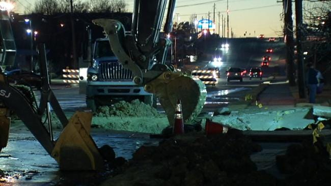 Cleanup Begins On 61st Street After Water Main Break